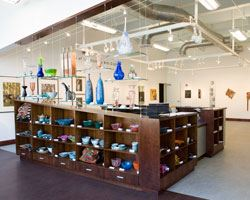 Gallery with glasswork display on shelves
