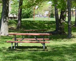 picnic tables on the lawn at john howard community center on a sunny day