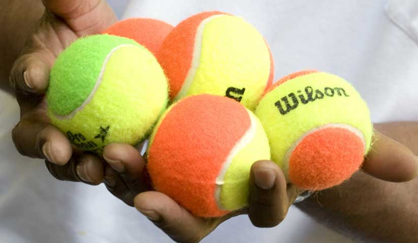costca-tennis-balls-in-hand