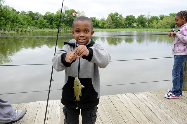 A boy with a fish in his hand