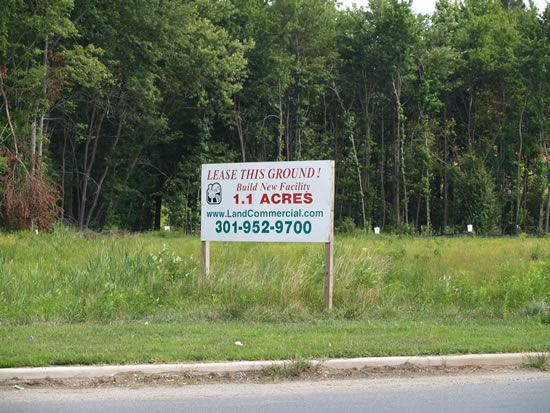 Lot for Sale with large sign advertising 1.1 acres for lease