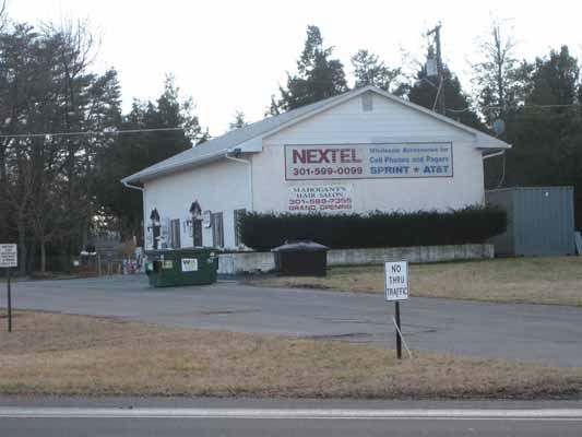 Building with a sign on the side that says Nextel